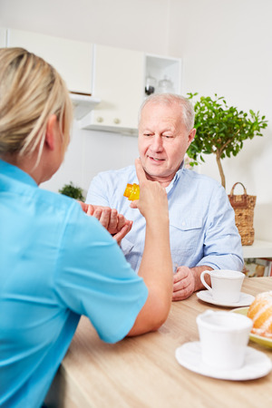 Nursing service and assistance for senior man with dementia Stock Photo