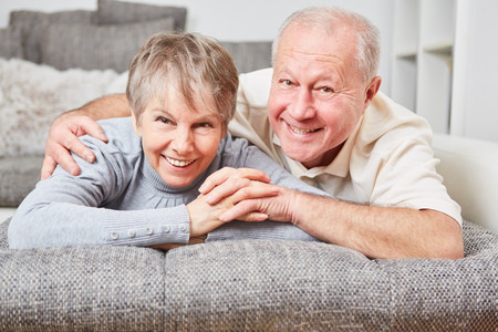 Happy senior couple together in love at home Standard-Bild