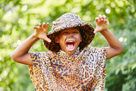 Creative kid playing leopard in theater and having fun Stock Photo