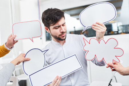 Man with speech bubbles for ideas and communication Stock Photo