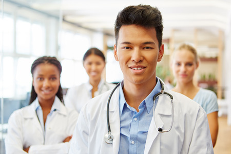 Young asian man as doctor assistant with interracial team