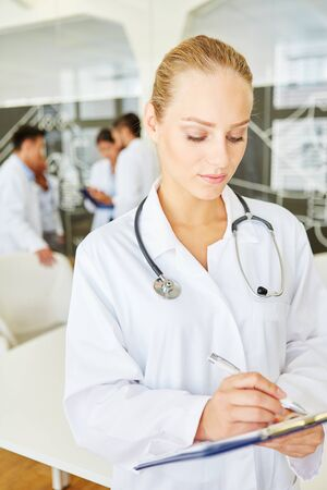 Nurse or doctor writing on patient record checklist therapy control