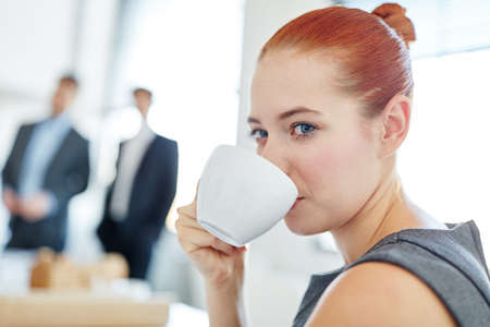 Businesswoman during coffee break at the office Stock Photo