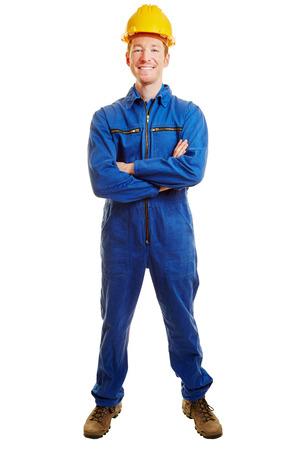 Smilng man als een bouwvakker met gekruiste armen en een bouwer