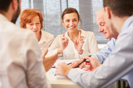 Woman and colleagues in business team together in consulting meeting