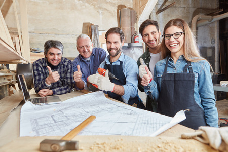 Carpenters team holding thumbs up for motivation Reklamní fotografie