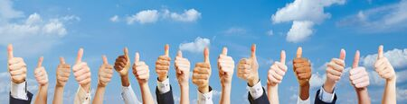 Many hands with thumbs up for success motivation
