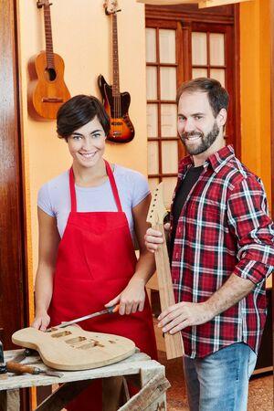 Luthier team in guitar workshop making new instrument Banque d'images