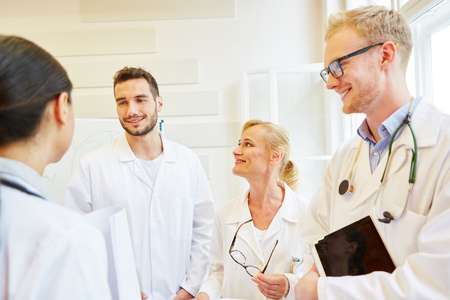 Doctors in meeting as colleagues in hospital