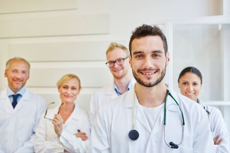 Man as doctor with medical team at hospital