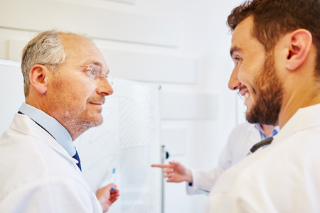 Senior physician trains student and discusses with him