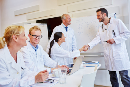 Doctor congratulates student for successful performance