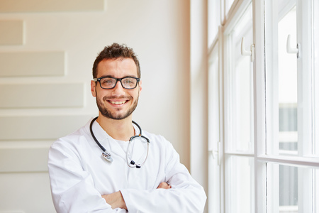 Self-confident competent doctor friendly smiling