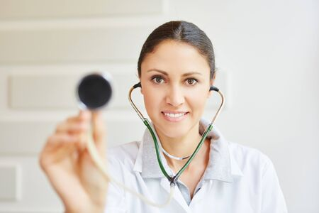 Woman doctor with stethoscope as medical tool