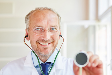 Friendly and kind senior doctor with stethoscope
