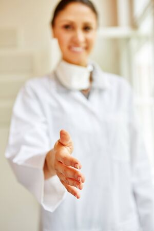 Woman as doctor giving handshake as a welcome gest