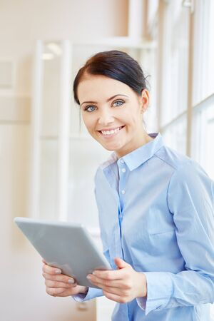 Successful businesswoman with tablet in start-up company