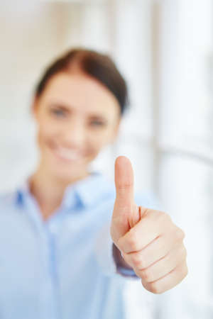 thumbs up as sign of consent, motivation and success