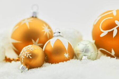 Christmas tree balls for background in yellow tones