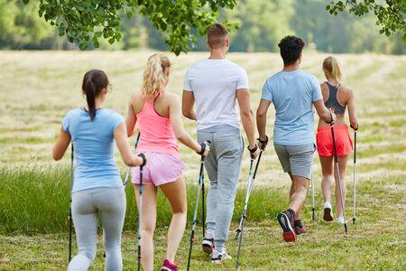 Young people in hiking club nordic walking in the nature 版權商用圖片 - 87657061