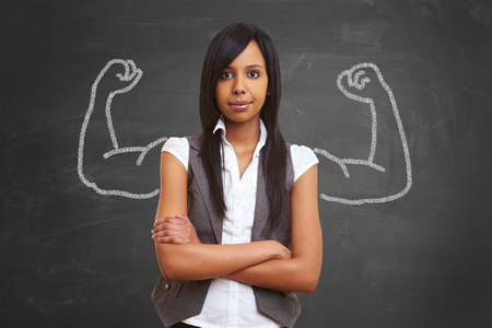 self assurance: Strong and powerful woman with self confidence and chalk muscles Stock Photo