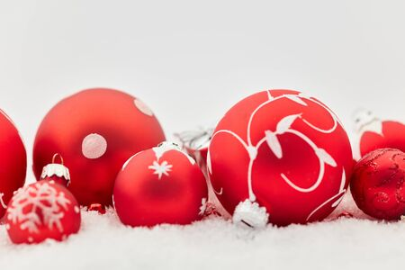 Background with red christmas baubles as decoration