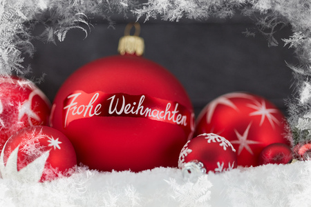 Frohe Weihnachten (Merry Christmas) greeting card with snow frame