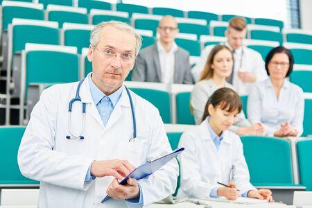 Senior man doctor or physician as medicine lecturer or professor Stock Photo