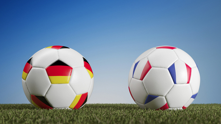 Soccer match between Germany and France with flags on balls (3D Rendering) Stock Photo