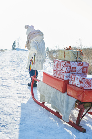 Christmas presents on sled transported by child