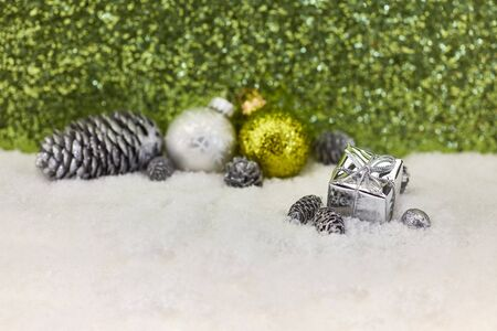 Christmas balls and cones on snow decoration as background