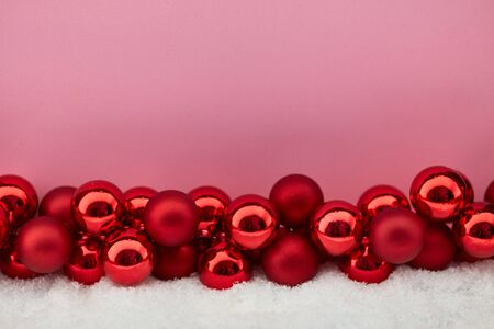 Pink christmas background with many small baubles Stock Photo
