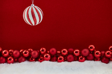 Christmas ball on red background with many baubles Stock Photo