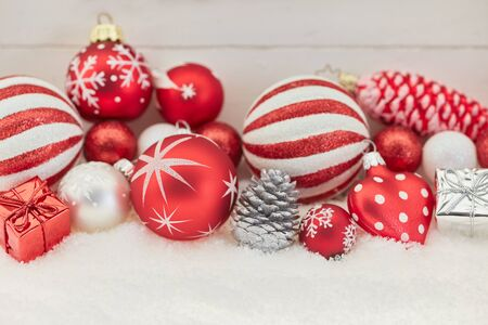 Christmas background decoration in red with snow  Lizenzfreie Bilder