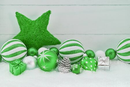 Christmas background in green with many christmas decoration items