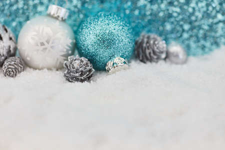 Christmas baubles on snow as background in winter