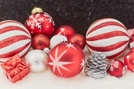 Red Christmas baubles decoration with snow as holiday card