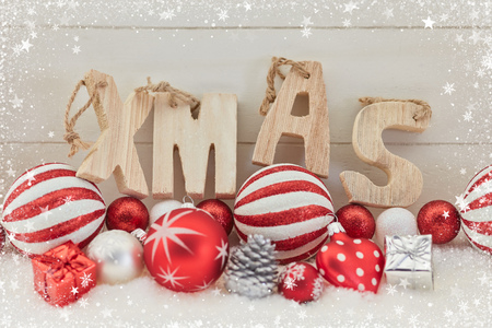 Xmas wooden text on christmas decoration as greeting card Lizenzfreie Bilder