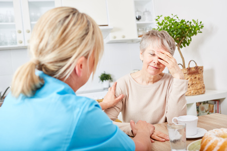Nursing service at home for senior woman with dementia Stock Photo