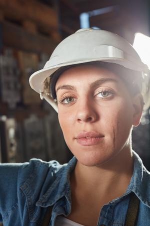 Woman as metalworker apprentice in metallurgy factory