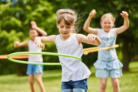 Children training their movement skills in the park