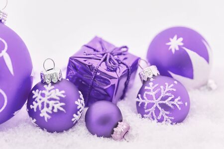 Purple christmas presents with snow as holiday background decoration