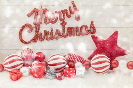 Merry Christmas text with snow and decoration for card