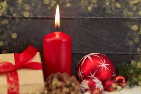 Christmas card with candle and gift in golden frame Stock Photo