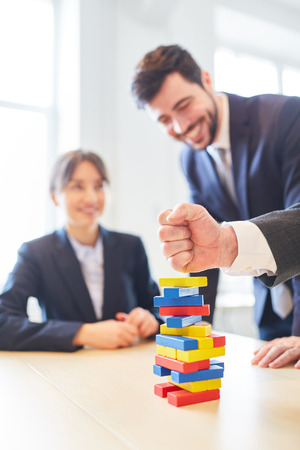 Clenched fist over stacked blocks for business team building workshop exercise Stock Photo