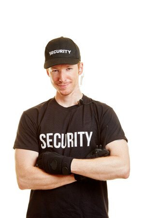 Man as a bouncer with security clothes and a radio