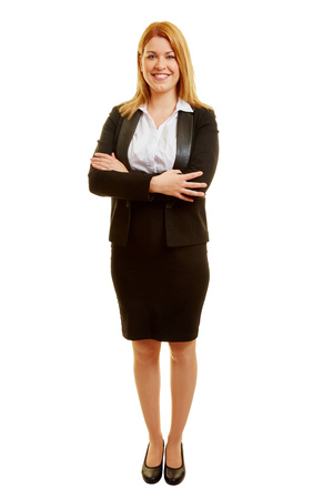 Smiling businesswoman with arms crossed and a skirt Stock Photo
