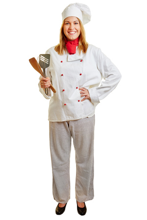 Woman as a chef smiling and standing contect