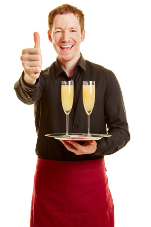 Waiter holding thumbs up and a tray with two glasses  Stock Photo