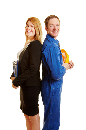 Business woman and construction worker as a team back to back Stock Photo